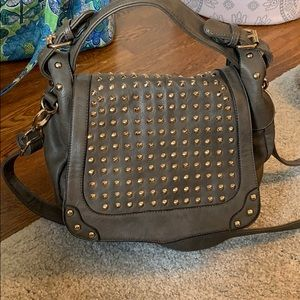 Green over the shoulder bag with gold studs